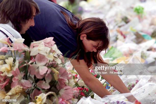 Sarah Payne's parents Sara and Michael pay a second visit to see the flowers and cards beside the A29 in Pulborough West Sussex where the body of...