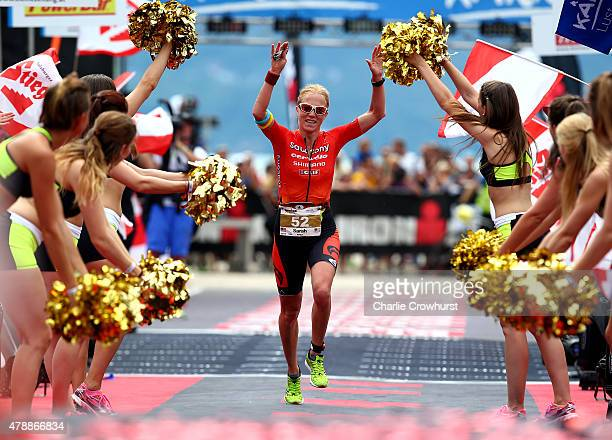 Sarah Piampiano of America celebrates third place in the womens race during Ironman Klagenfurt on June 28 2015 in Klagenfurt Austria