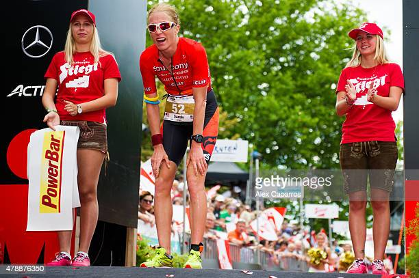 Sarah Piampiano of the United States reacts after finishing in third place Ironman Klagenfurt on June 28 2015 in Klagenfurt Austria