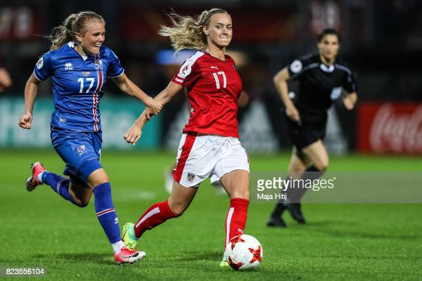 Sarah Puntigam of Austria and Agla Maria Albertsdottir of Iceland battle for the ball during the Group C match between Iceland and Austria during the...