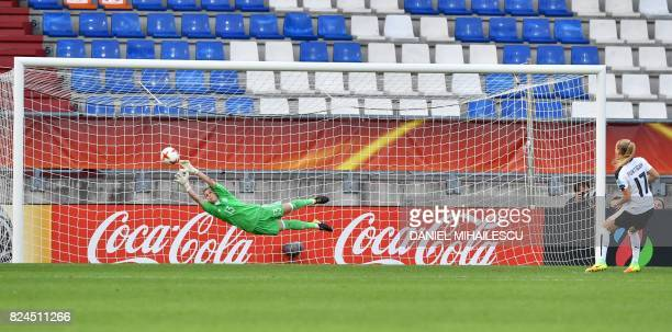 Sarah Puntigam of Austria scores a winning penalty goal during the UEFA Womens Euro 2017 quarterfinal football match between Austria and Spain at the...