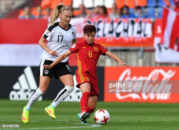 Sarah Puntigam of Austria vies with Amanda Sampedro of Spain during the UEFA Women's Euro 2017 quarterfinal football match between Austria and Spain...