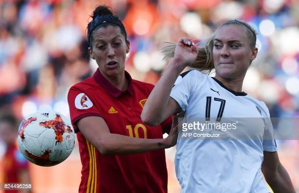 Sarah Puntigam of Austria vies with Jennifer Hermoso of Spain during the UEFA Women's Euro 2017 quarterfinal football match between Austria and Spain...