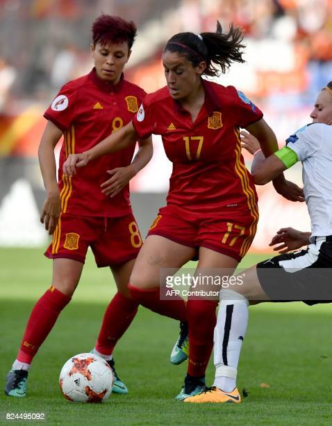 Sarah Puntigam of Austria vies with Olga Garcia of Spain during the UEFA Women's Euro 2017 quarterfinal football match between Austria and Spain at...