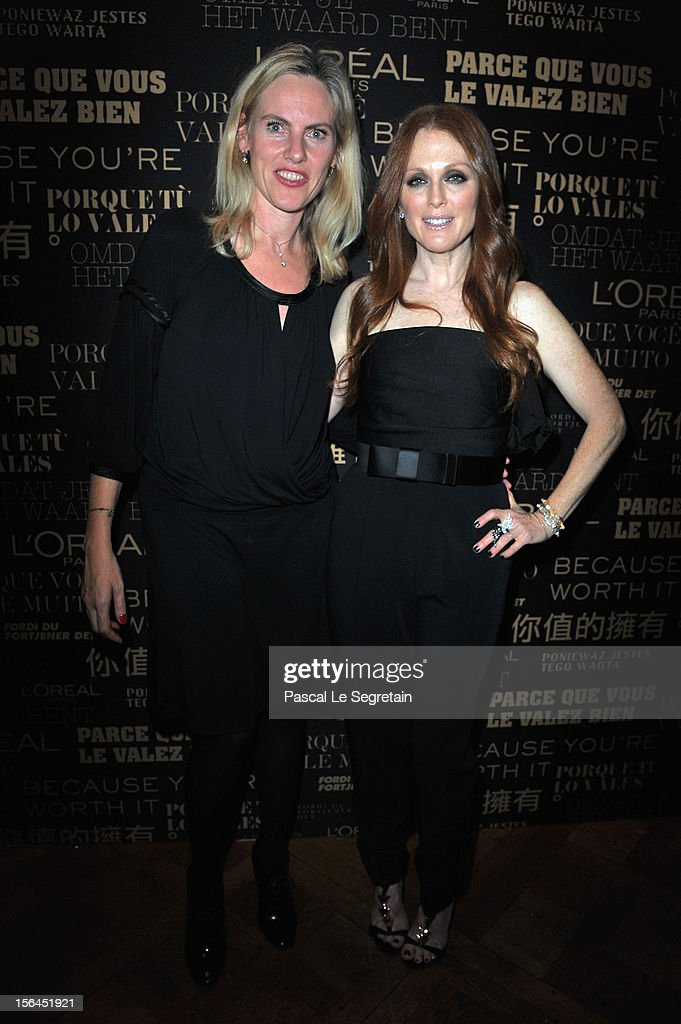 Sarah Ravella and <a gi-track='captionPersonalityLinkClicked' href=/galleries/search?phrase=Julianne+Moore&family=editorial&specificpeople=171555 ng-click='$event.stopPropagation()'>Julianne Moore</a> pose during the l'Oreal new egerie presentation at Hotel D'Evreux on November 15, 2012 in Paris, France.
