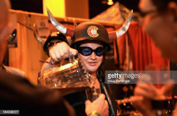 Sarah Rickert pours beer for Bull Bush Brewery of Denver Colorado during the 32nd annual Great American Beer Festival at the Colorado Convention...