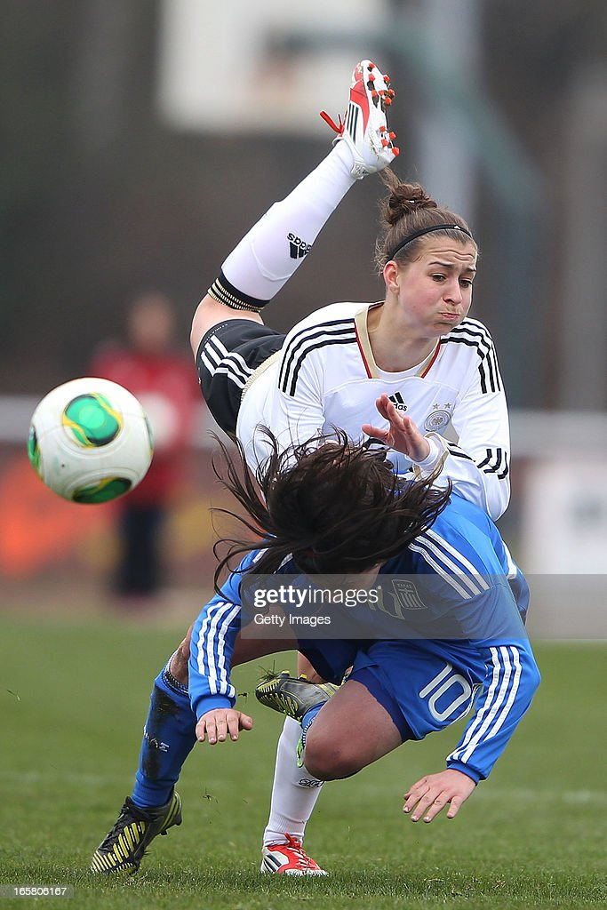 Sarah Romert of Germany jumps for a header with Christina Kokoviadou (#10) of Greece during the Women's UEFA U19 Euro Qualification match between U19 Germany and U19 Greece at Sportzentrum Sued on April 6, 2013 in Kirchheim, Germany.
