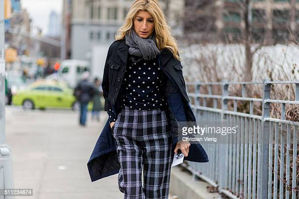 Sarah Rutson is wearing plaid wide leg pants seen outside Michael Kors during New York Fashion Week Women's Fall/Winter 2016 on February 17 2016 in...