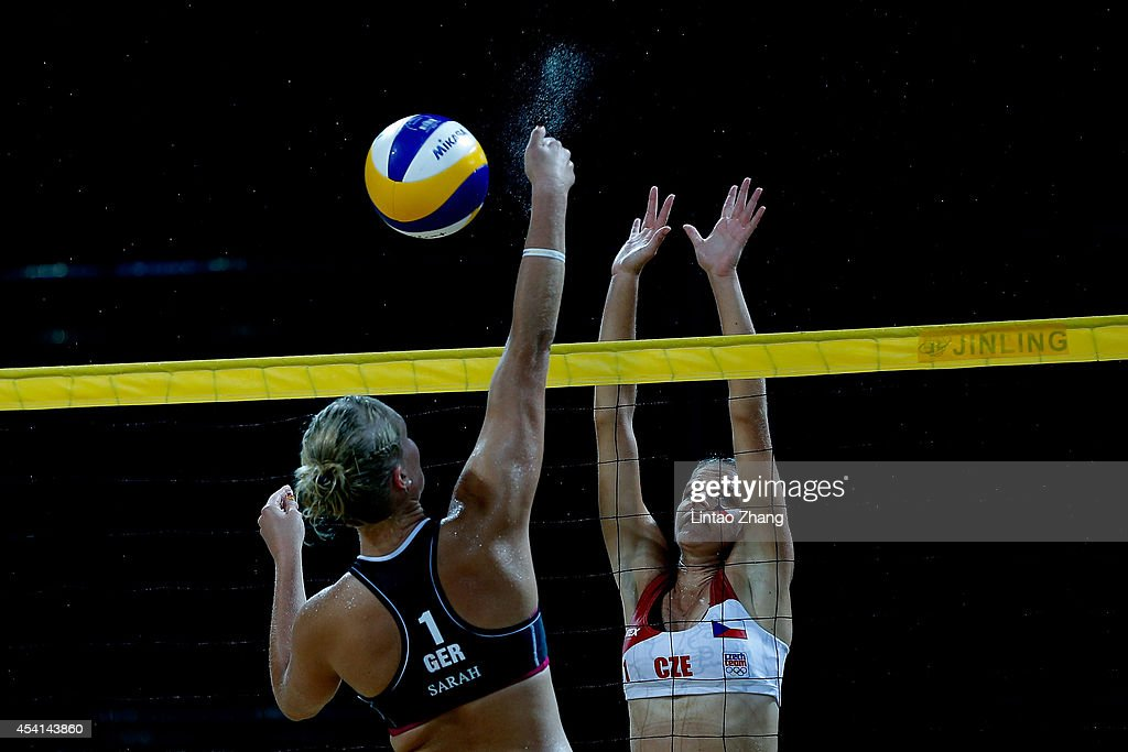 Sarah Schneider (L) of Germany compete Katerina Valkova of Czech during the Women's Quarterfinal on day nine of Nanjing 2014 Summer Youth Olympic Games at Sports Park Beach Volley Venue on August 25, 2014 in Nanjing, China.