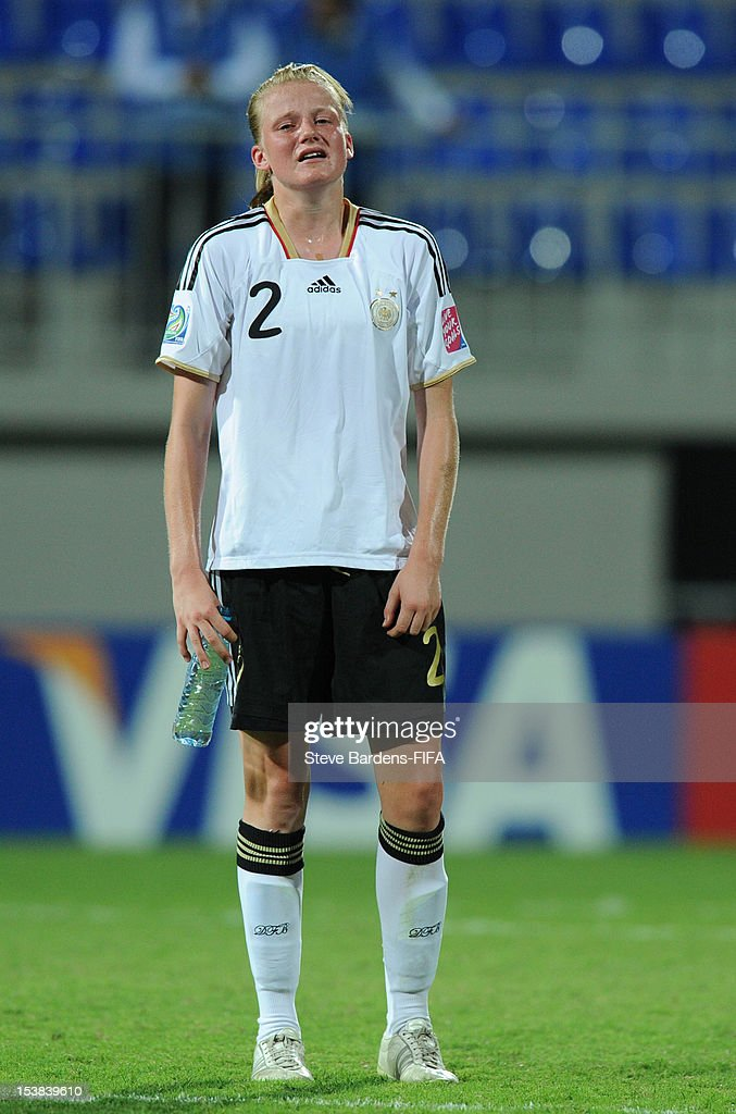 Sarah Schulte of Germany stands dejected at the final whistle of the FIFA U-17 Women's World Cup 2012 Semi-Final match between Korea DPR and Germany at 8KM Stadium on October 9, 2012 in Baku, Azerbaijan.