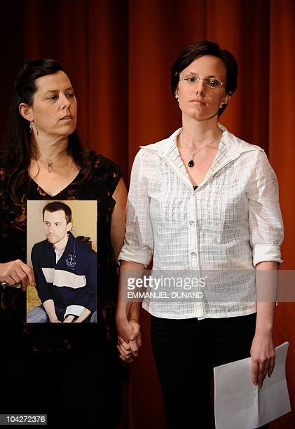 Sarah Shourd the American hiker released from detention in Iran after 410 days and her fiance Shane Bauer's mother Cindy Hickey hold hands during a...