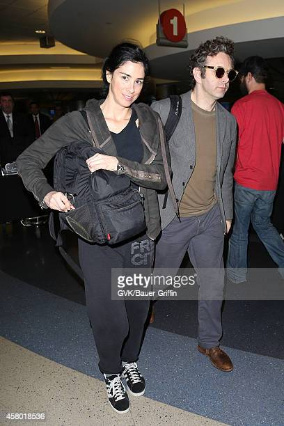 Sarah Silverman and Michael Sheen seen at LAX on October 28 2014 in Los Angeles California