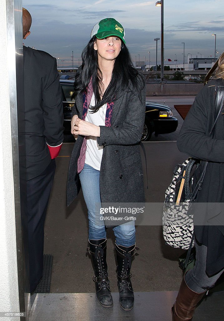 <a gi-track='captionPersonalityLinkClicked' href=/galleries/search?phrase=Sarah+Silverman&family=editorial&specificpeople=241299 ng-click='$event.stopPropagation()'>Sarah Silverman</a> is seen at Los Angeles International airport on December 17, 2013 in Los Angeles, California.