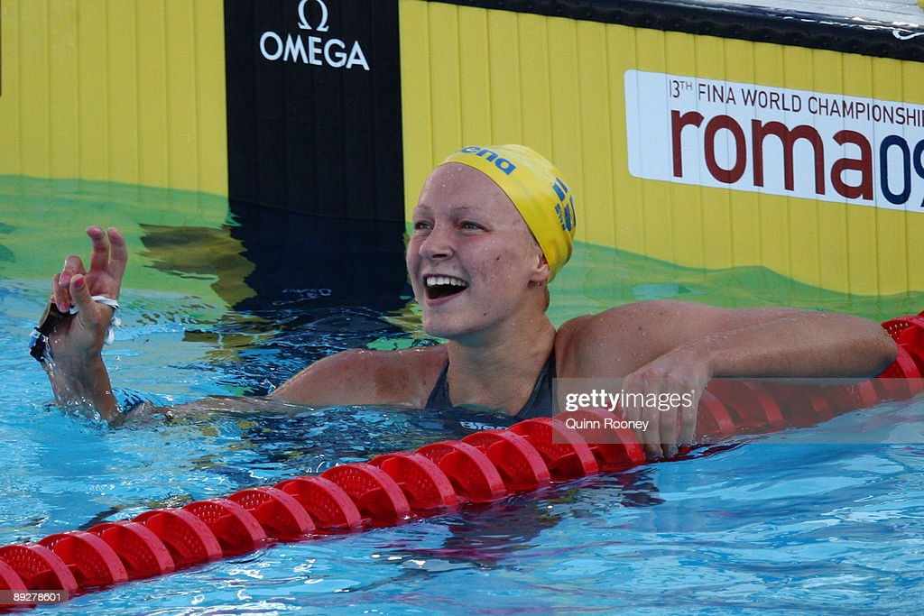 Sarah Sjostrom of Sweden celebrates after breaking the world record, setting a new time of 56.06 seconds in the Women's 100m Butterfly Final during the 13th FINA World Championships at the Stadio del Nuoto on July 27, 2009 in Rome, Italy.