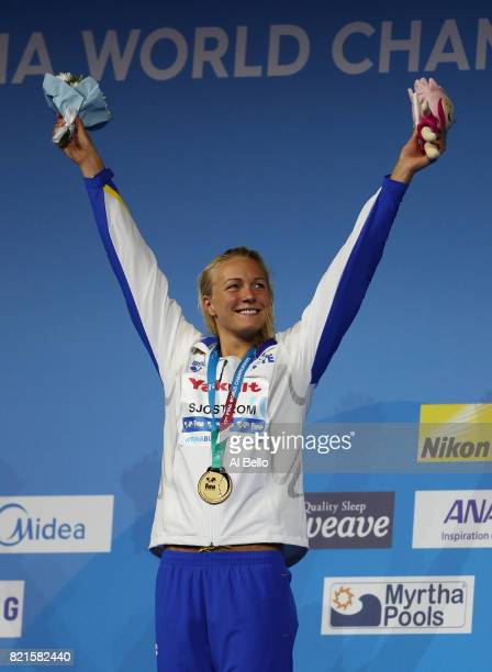 Sarah Sjostrom of Sweden celebrates winning gold in the Women's 100m Butterfly Final on day eleven of the Budapest 2017 FINA World Championships on...