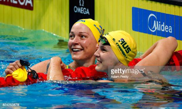 Sarah Sjostrom of Sweden is congratulated by Bronte Campbell of Australia after setting a new world record time of 2667 during the Women's 50m...