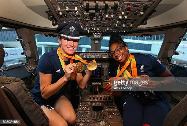 Sarah Storey and Kadeena Cox of the Paralympics GB Team shows her medals in the flight deck they prepare to fly back from Galeao Airport on British...