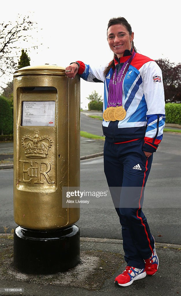<a gi-track='captionPersonalityLinkClicked' href=/galleries/search?phrase=Sarah+Storey&family=editorial&specificpeople=5521640 ng-click='$event.stopPropagation()'>Sarah Storey</a> poses with her Paralympic medals next to a Royal Mail post box painted in honour of her Paralympic gold medals in the village of Poynton on September 14, 2012 in Stockport, England. <a gi-track='captionPersonalityLinkClicked' href=/galleries/search?phrase=Sarah+Storey&family=editorial&specificpeople=5521640 ng-click='$event.stopPropagation()'>Sarah Storey</a> was a student at Poynton High School where the gold post box is situated.