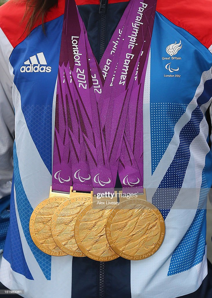 <a gi-track='captionPersonalityLinkClicked' href=/galleries/search?phrase=Sarah+Storey&family=editorial&specificpeople=5521640 ng-click='$event.stopPropagation()'>Sarah Storey</a> shows her four Paralympic gold medals as she poses next to a Royal Mail post box painted in honour in the village of Poynton on September 14, 2012 in Stockport, England. <a gi-track='captionPersonalityLinkClicked' href=/galleries/search?phrase=Sarah+Storey&family=editorial&specificpeople=5521640 ng-click='$event.stopPropagation()'>Sarah Storey</a> was a student at Poynton High School where the gold post box is situated.