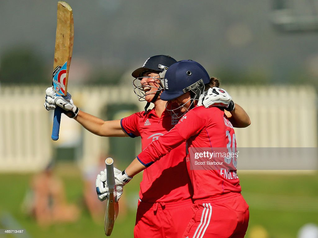 Sarah Taylor and <a gi-track='captionPersonalityLinkClicked' href=/galleries/search?phrase=Charlotte+Edwards&family=editorial&specificpeople=618915 ng-click='$event.stopPropagation()'>Charlotte Edwards</a> of England celebrate after winning the match and retaining the Ashes during game one of the International Twenty20 series between Australia and England at Blundstone Arena on January 29, 2014 in Hobart, Australia.
