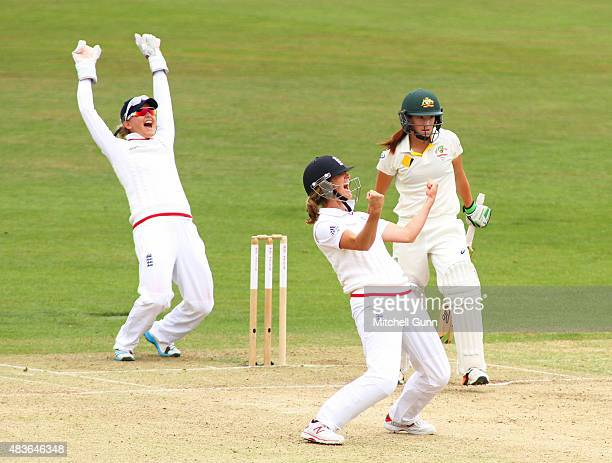 Sarah Taylor and Charlotte Edwards of England celebrate the wicket of Megan Schutt of Australia during day one of the Kia Women's Test of the Women's...