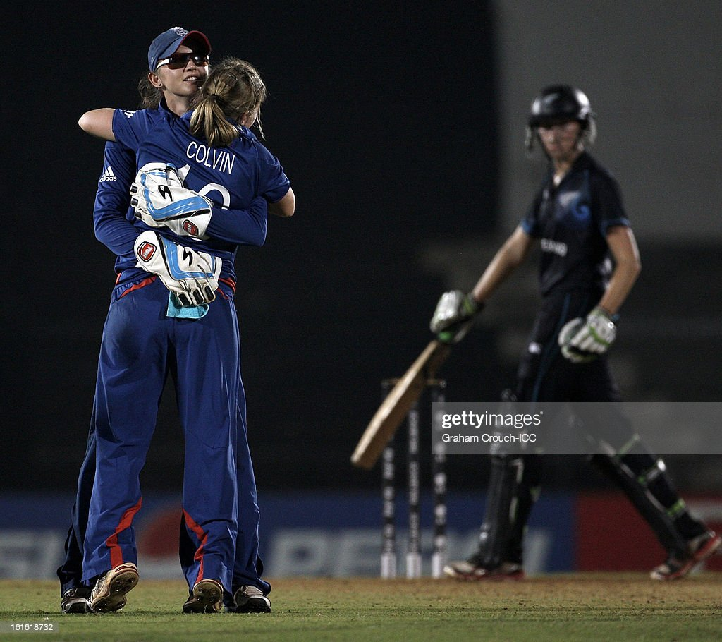 Sarah Taylor and Holly Colvin of England celebrate the wicket of Sophie Devine of New Zealand during of the Super Sixes ICC Women's World Cup India 2013 match between New Zealand and England at the Cricket Club of India ground on February 13, 2013 in Mumbai, India.