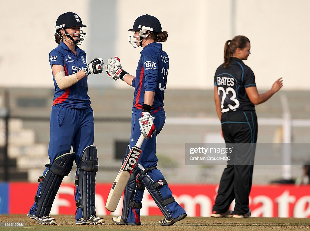 Sarah Taylor and Lydia Greenway of England celebrates after Taylor hit a six after being given a reprieve from Suzy Bates of New Zealand for a no ball during of the Super Sixes ICC Women's World Cup India 2013 match between New Zealand and England at the Cricket Club of India ground on February 13, 2013 in Mumbai, India.