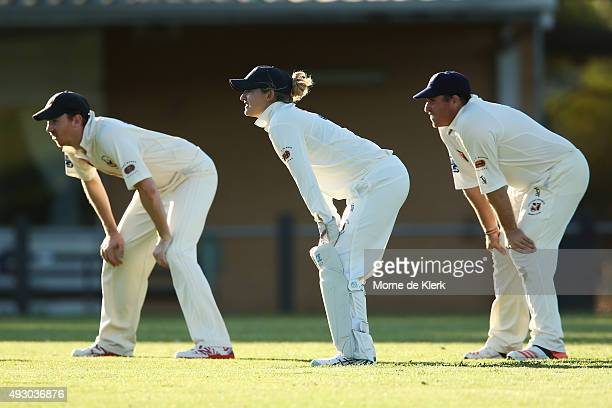 Sarah Taylor keeps wicket as she stands with her male teammates in the men's AGrade match between Northern Districts and Port Adelaide on October 17...