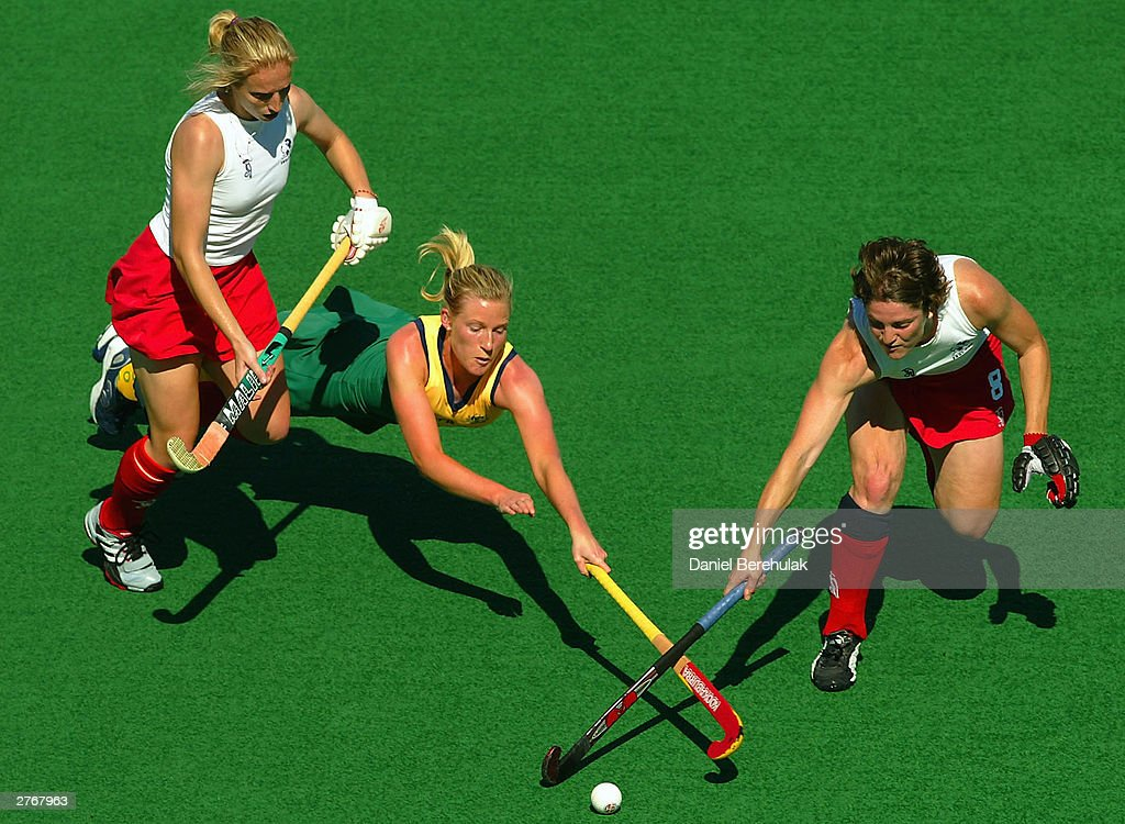 Sarah Taylor of Australia dives to intercept a pass between Lucilla Wright and Anna Bennett of England during the BDO Hockey Champions Trophy match...
