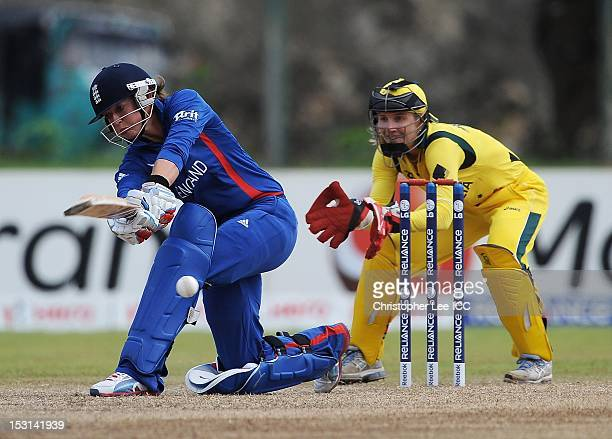 Sarah Taylor of England bats as wicketkeeper Jodie Fields of Australia watches from the stumps during the ICC Women's World Twenty20 2012 Group A...