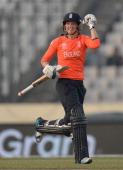 Sarah Taylor of England celebrates hitting the winning runs to win the ICC Womens World Twenty20 Bangladesh 2014 semi final between England and South...
