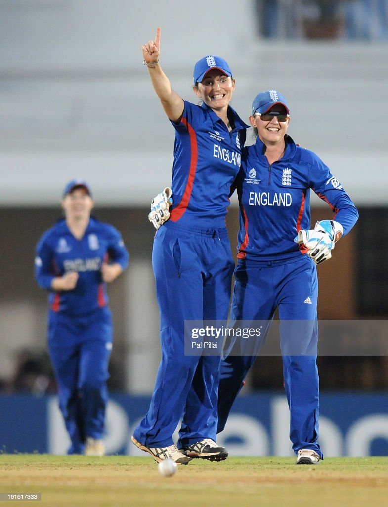 Sarah Taylor of England celebrates the wicket of Lucy Doolan of New Zealand with team captain <a gi-track='captionPersonalityLinkClicked' href=/galleries/search?phrase=Charlotte+Edwards&family=editorial&specificpeople=618915 ng-click='$event.stopPropagation()'>Charlotte Edwards</a> during the Super Sixes match between England and New Zealand held at the CCI (cricket club of India) on February 13, 2013 in Mumbai, India.