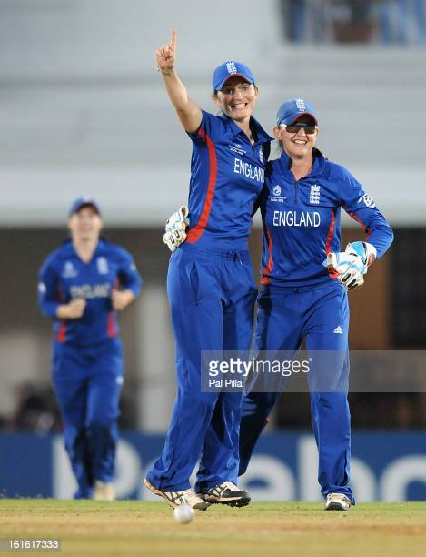 Sarah Taylor of England celebrates the wicket of Lucy Doolan of New Zealand with team captain Charlotte Edwards during the Super Sixes match between...