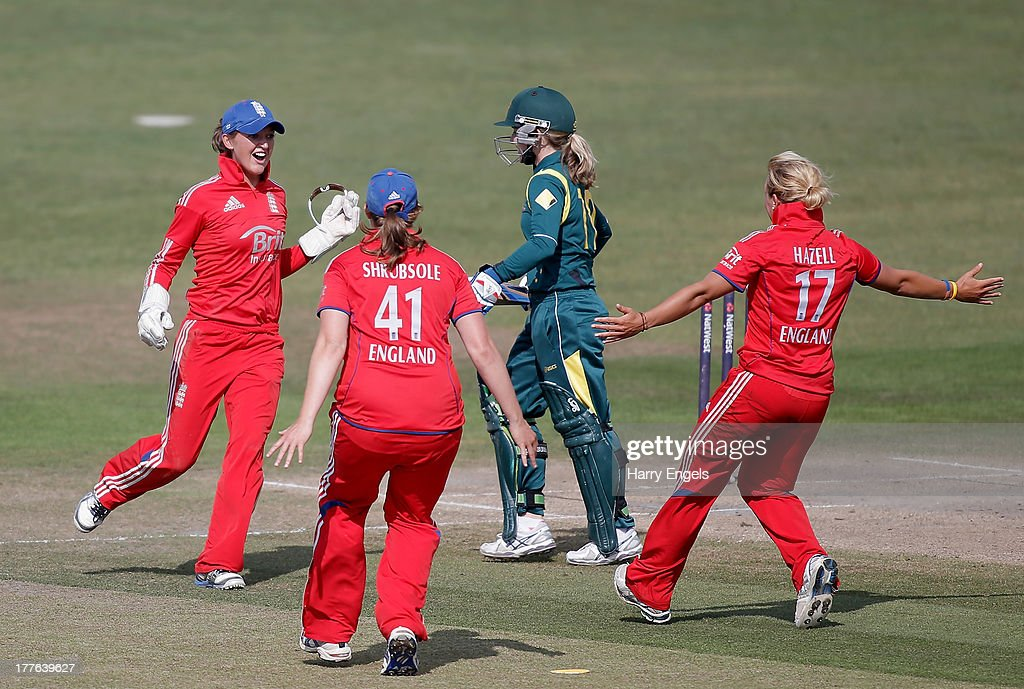 Sarah Taylor of England (L) celebrates with teammates after dismissing <a gi-track='captionPersonalityLinkClicked' href=/galleries/search?phrase=Jodie+Fields&family=editorial&specificpeople=5576479 ng-click='$event.stopPropagation()'>Jodie Fields</a> of Australia (C) during the third NatWest One Day International match between England and Australia at the BrightonandHoveJobs.com County Ground on August 25, 2013 in Hove, England.