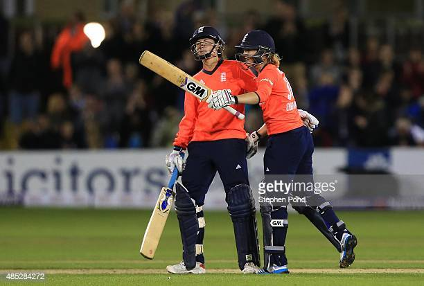 Sarah Taylor of England embraces team mate Natalie Sciver as she celebrates reaching fifty runs during the first Natwest T20 match of the Women's...