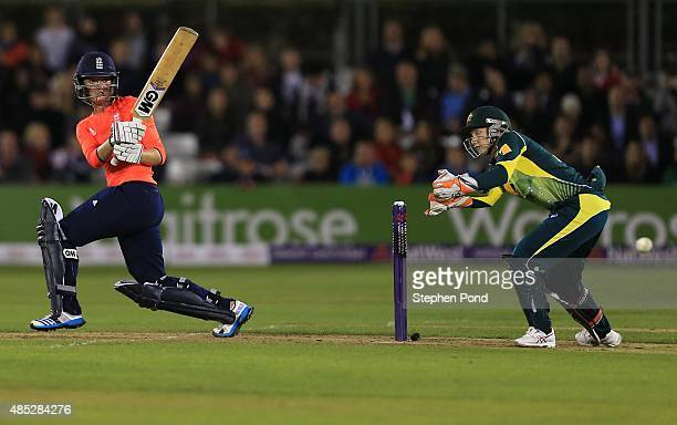 Sarah Taylor of England hits out as Alyssa Healy of Australia looks on during the first Natwest T20 match of the Women's Ashes Series between England...