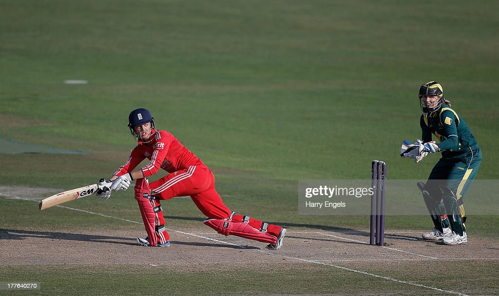 Sarah Taylor of England hits out watched by Australian wicketkeeper Jodie Fields during the third NatWest One Day International match between England and Australia at the BrightonandHoveJobs.com County Ground on August 25, 2013 in Hove, England.