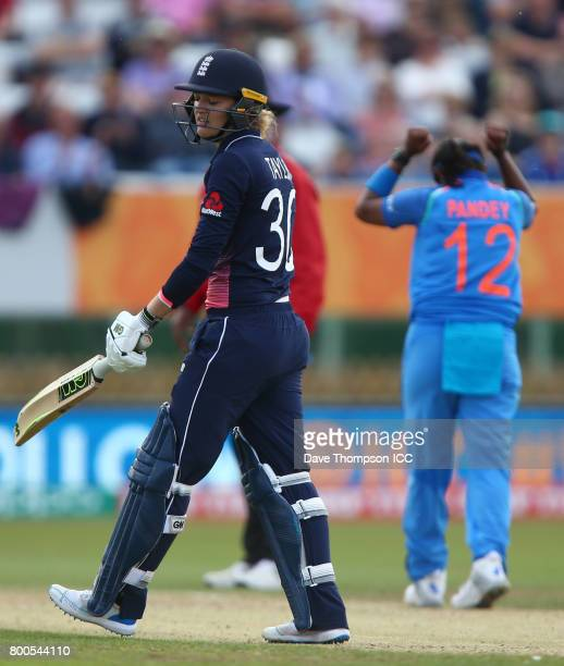 Sarah Taylor of England looks dejected after losing her wicket to Shikha Pandey of India during the ICC Women's World Cup match between England and...
