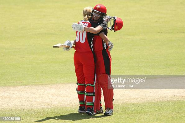 Sarah Taylor of South Australia is embraced by Lauren Ebsary after scoring her century during the round one WNCL match between New South Wales and...
