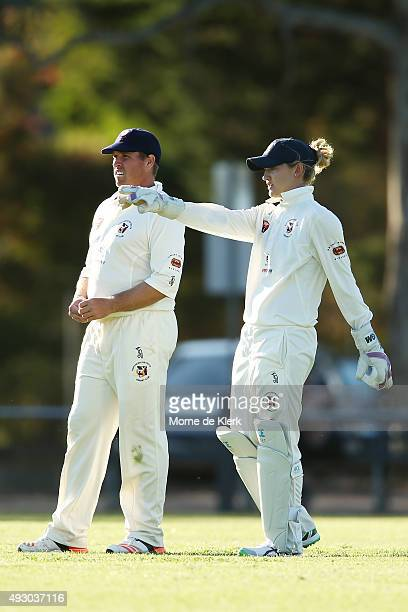 Sarah Taylor speaks to a teammate while she competes in the men's AGrade match between Northern Districts and Port Adelaide on October 17 2015 in...