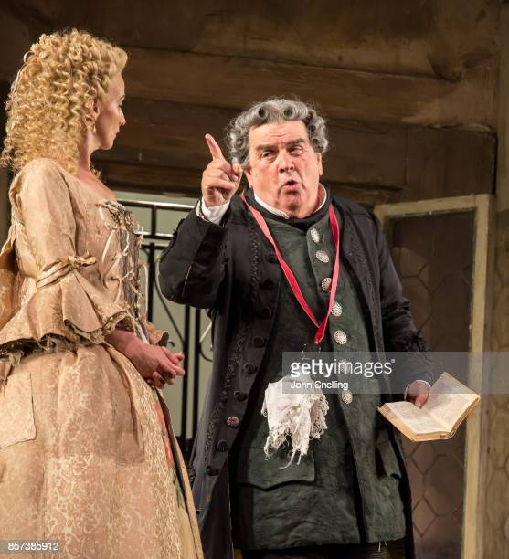 Sarah Tynan as Rosina and Alan Opie as Bartolo perform on stage during a performance of Jonathan Millers classic production of 'The Barber of...