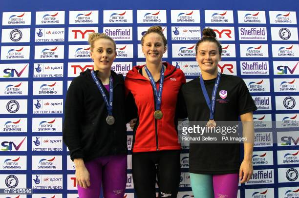 Sarah Vasey poses with her gold medal after winning the Women's 100 metres breaststroke along side second placed SiobhanMarie O'Connor and third...