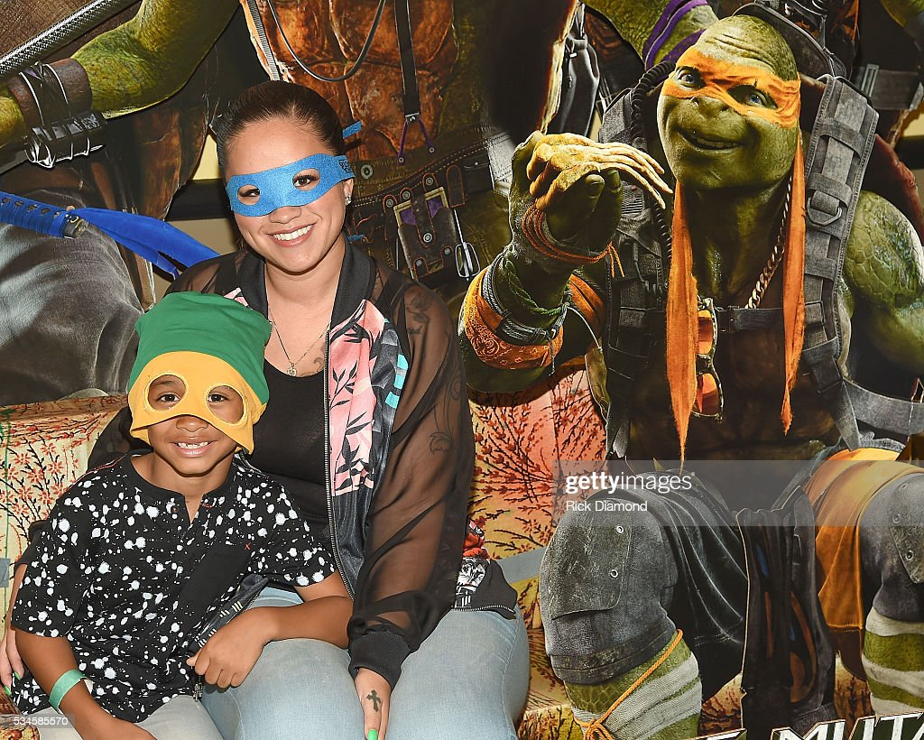 Sarah ViVan and Dwayne Michael Carter III attend the Atlanta Screening of the Paramount Pictures title 'Teenage Mutant Ninja Turtles: Out of the Shadows', on May 26, 2016 at AMC Phipps Plaza in Atlanta, Georgia.