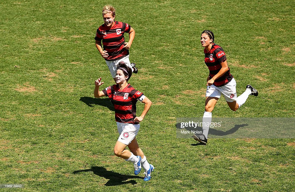 Sarah Walsh, Catherine Cannuli and Olivia Kennedy of the Wanderers celebrate a goal by Walsh during the round six W-League match between the Western Sydney Wanderers and the Newcastle Jets at Campbelltown Sports Stadium on November 25, 2012 in Sydney, Australia.
