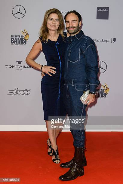 Sarah Wiener and Ivan Strano attend the Tribute To Bambi 2014 at Station on September 25 2014 in Berlin Germany
