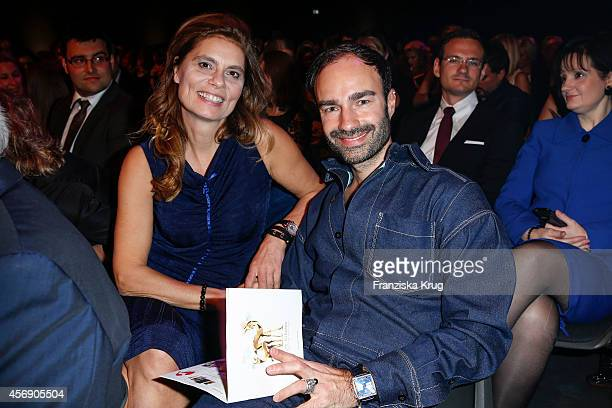 Sarah Wiener and Ivan Strano attend the Tribute To Bambi 2014 on September 25 2014 in Berlin Germany