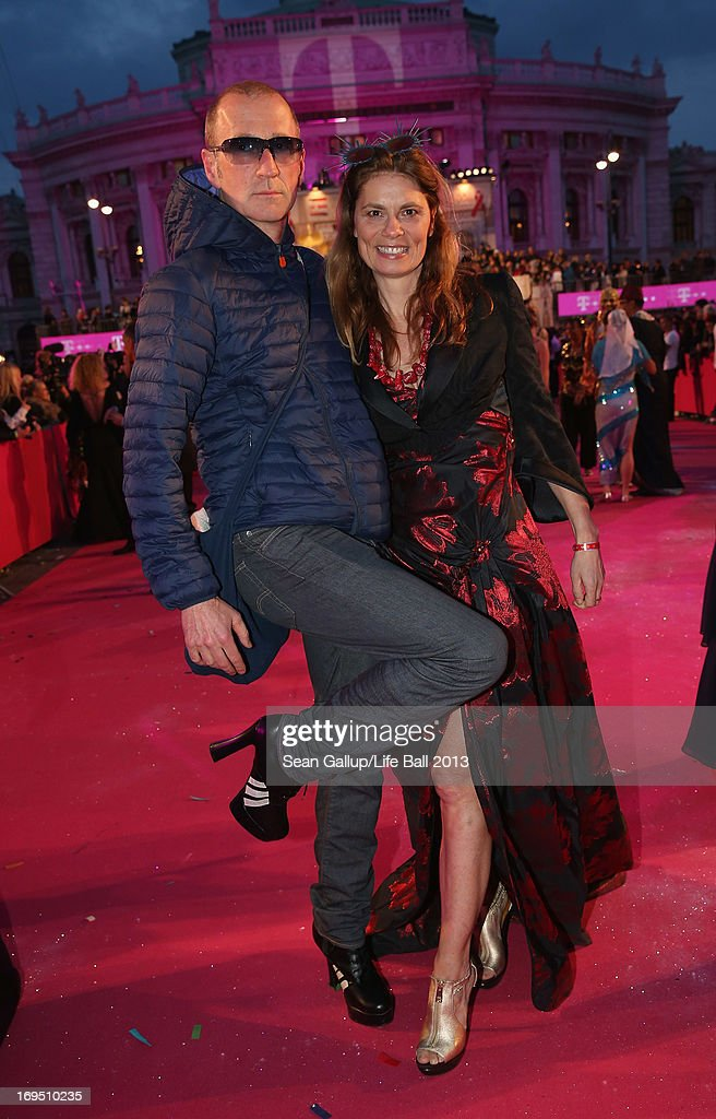 Sarah Wiener and Peter Lohmeyer arrive on the Magenta Carpet at the 2013 Life Ball at City Hall on May 25, 2013 in Vienna, Austria.