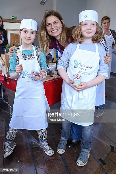 Sarah Wiener poses with kids during the cooking event 'Wie schmeckt das denn' hosted by the magazine ZEIT Leo and cook Sarah Wiener at Kalkscheune on...
