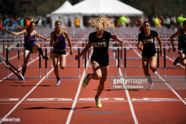 Sarah Yocum of Faith Christian with her hair flying in her face crosses the finish line to win the girls 3A 100 meter hurdles during the final day of...
