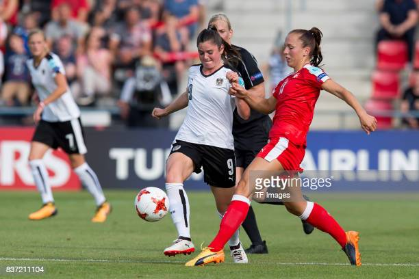 Sarah Zadrazil of Austria and Lia Waelti of Switzerland battle for the ball during the Group C match between Austria and Switzerland during the UEFA...